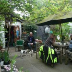 Dog walkers and motorcyclists on the patio.